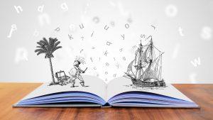 """Aufgeklapptes Buch, auf welchem 3D Zeichnungen stehen """"Visual Storytelling- Die hohe Kunst des Marketings""""."""